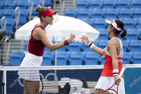 Belinda Bencic of Switzerland (L) and Misaki Doi (R) of Japan shake hands after their second round match in the women's single tennis competition at the 2020 Tokyo Summer Olympics at the Ariake Tennis Park in Tokyo, Japan, 26 July 2021.