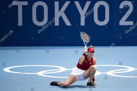 Stock Image of Belinda Bencic of Switzerland challenges a call during her second round match against Misaki Doi of Japan in the women's single tennis competition at the 2020 Tokyo Summer Olympics at the Ariake Tennis Park in Tokyo, Japan, 26 July 2021.