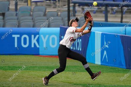Canada's Jennifer Gilbert catches a foul out during a softball game against Canada at Yokohama Baseball Stadium during the 2020 Summer Olympics, in Yokohama, Japan