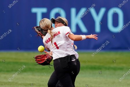Canada's Kelsey Harshman, left, and Jennifer Gilbert collide while trying to catch a pop up during a softball game against Italy at Yokohama Baseball Stadium during the 2020 Summer Olympics, in Yokohama, Japan