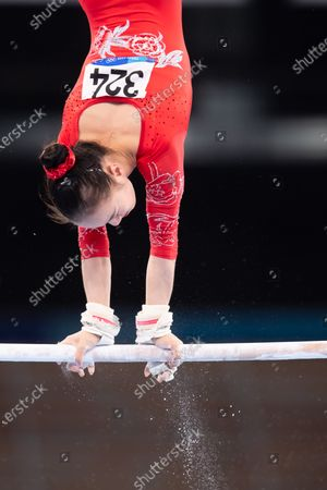 Jin Zhang (324) of China on uneven bars during the Tokyo Olympic Games Women's Qualification at the Ariake Gymnastics Centre in Tokyo, Japan}