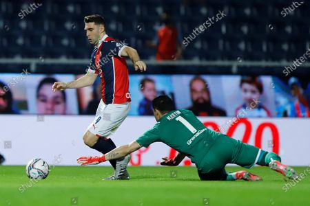 Mauro Boselli (L) of Cerro vies for the ball with Martin Silva of Libertad during the Clausura tournament soccer match in Asuncion, Paraguay, 25 July 2021 (issued 26 July 2021).