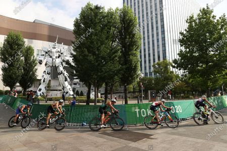 Dorian Coninx of France, right, rides ahead of Alex Yee of Britain, Joao Pereira of Portugal, Justus Nieschlag of Germany and Delian Stateff of Italy as they compete in the bike leg during the men's individual triathlon at the 2020 Summer Olympics, in Tokyo, Japan