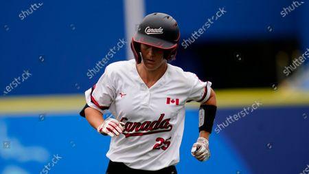 Stock Picture of Canada's Jennifer Gilbert runs during a softball game against Italy at Yokohama Baseball Stadium during the 2020 Summer Olympics, in Yokohama, Japan