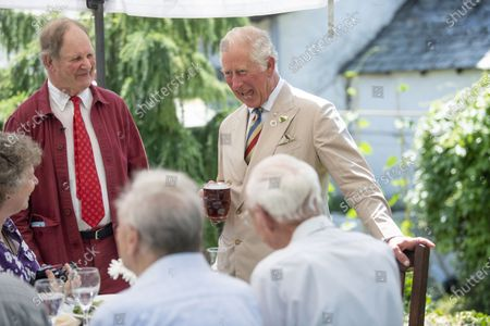 Prince Charles visits to Prince Charles of York Public House in deepest Devon.They had lunch with the local reading Group and local writer Sir Michael Morpurgo