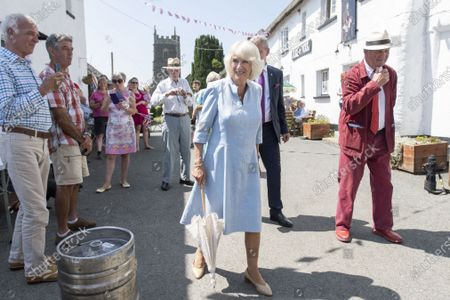 Prince Charles and Camilla Duchess of Cornwall visit to Prince Andrew Public House in deepest Devon. They had lunch with the local reading Group and local writer Sir Michael Morpurgo