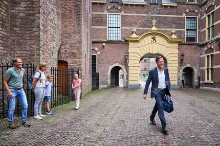 Outgoing Dutch Prime Minister Mark Rutte (R) arrives at the Binnenhof in The Hague, the Netherlands, 26 July 2021. During the summer holidays, the Dutch Cabinet will provide an update on the coronavirus disease (COVID-19) crisis every Monday.
