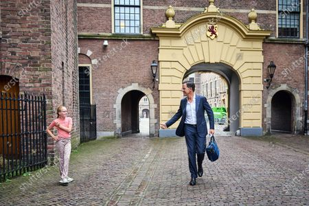 Stock Photo of Outgoing Dutch Prime Minister Mark Rutte (R) arrives at the Binnenhof in The Hague, the Netherlands, 26 July 2021. During the summer holidays, the Dutch Cabinet will provide an update on the coronavirus disease (COVID-19) crisis every Monday.