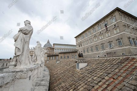 Stock Photo of Pope Francis delivers the Sunday Angelus prayer from the window of his study overlooking St.Peter's Square at the Vatican