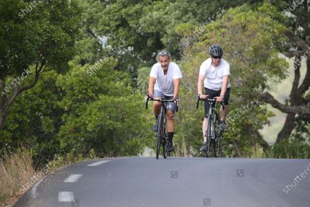Editorial image of Former President Nicolas Sarkozy is cycling during his vacation, Cap Negre, France - 26 Jul 2021