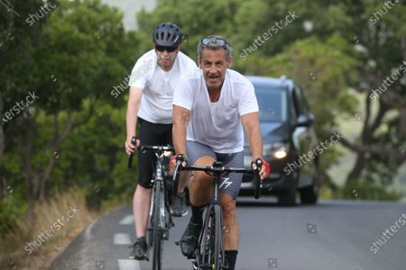 Editorial photo of Former President Nicolas Sarkozy is cycling during his vacation, Cap Negre, France - 26 Jul 2021