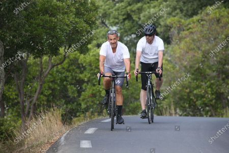 Editorial picture of Former President Nicolas Sarkozy is cycling during his vacation, Cap Negre, France - 26 Jul 2021