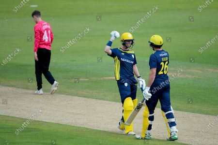 Nick Gubbins of Hampshire congratulates James Fuller on hitting a boundary during the Royal London One Day Cup match between Hampshire and Sussex Sharks at The Ageas Bowl, Southampton