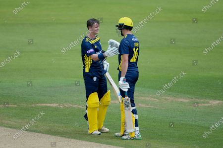 Stock Photo of Nick Gubbins of Hampshire is congratulated by James Fuller on his century during the Royal London One Day Cup match between Hampshire and Sussex Sharks at The Ageas Bowl, Southampton