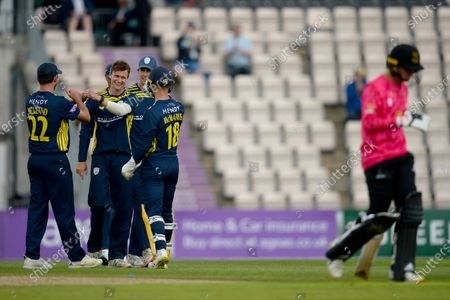 Nick Gubbins and Hampshire team-mates celebrate the wicket of James Coles during the Royal London One Day Cup match between Hampshire and Sussex Sharks at The Ageas Bowl, Southampton