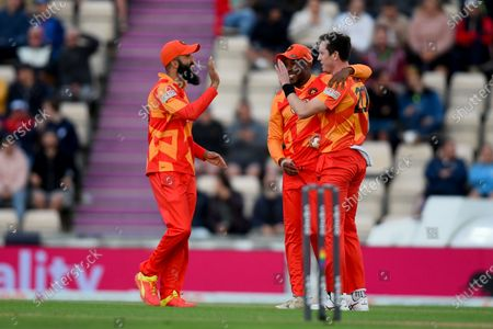 Moeen Ali (left), Adam Milne and Daniel Bell-Drummond of Birmingham Phoenix celebrate the wicket of Quinton De Kock during the The Hundred match between Southern Brave and Birmingham Phoenix at The Ageas Bowl, Southampton