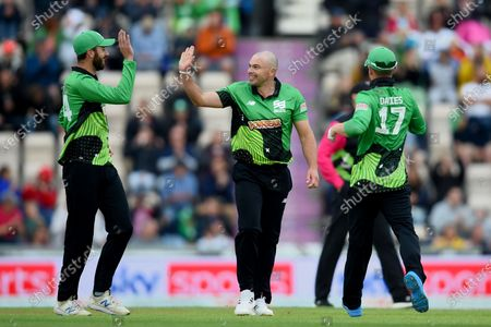 Jake Lintott, James Vince and Alex Davies of Southern Brave celebrate the wicket of Moeen Ali during the The Hundred match between Southern Brave and Birmingham Phoenix at The Ageas Bowl, Southampton