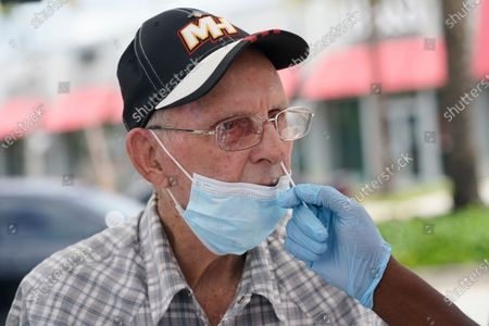 Stock Photo of Alberto Rodriguez gets a COVID-19 rapid test, in Miami. Rodriguez needs a negative test to be able to visit his wife at a nursing home. Florida accounted for a fifth of the nation's new infections last week, more than any other state, according to the U.S. Centers for Disease Control and Prevention