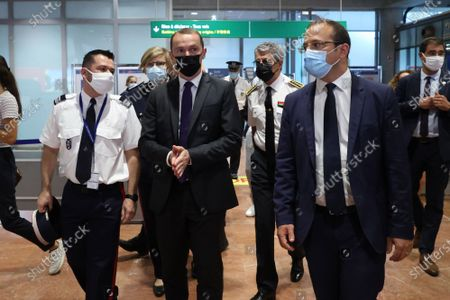 Stock Image of Visit of (C) Olivier Dussopt (Minister Delegate for Public Accounts), (D) Anthony Borre (first deputy of Christian Estrosi in charge of security), to attend a control operation carried out by customs officials on non-Community flights upon arrival in France, Nice-Côte d'Azur Airport,