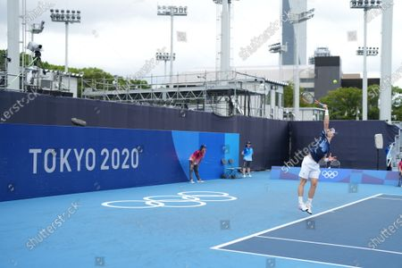 Murray serves in the Andy Murray (GB) and Joe Salisbury (GB) versus Kevin Krawietz (Ger) and Tim Puetz (Ger) doubles match; Ariake Tennis Center, Tokyo, Japan; Olympic Tennis competition, Day 4 of Tokyo 2020 Summer Olympic Games.