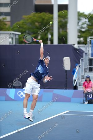 Murray serves in the Andy Murray (GB) and Joe Salisbury (GB) versus Kevin Krawietz (Ger) & Tim Puetz (Ger) doubles match; Ariake Tennis Center, Tokyo, Japan; Olympic Tennis competition, Day 4 of Tokyo 2020 Summer Olympic Games.
