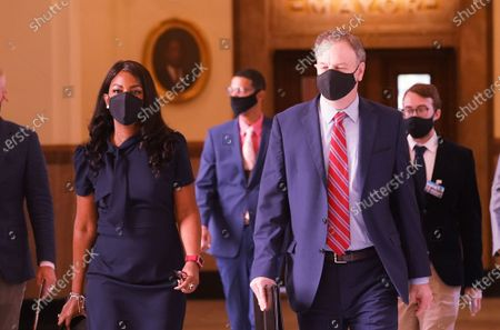 St. Louis Mayor Tishaura Jones and St. Louis County Executive Dr. Sam Page walk to a press conference at St. Louis City Hall to announce the City of St. Louis and St. Louis County will require people to wear masks while in public, in St. Louis on Monday, July 26, 2021. The mask order is being put into place since cases in the St. Louis region have begun to rise and the Delta variant of the coronavirus has become dominant across Missouri.