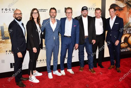 """Stock Image of Focus Features chairman Peter Kujawski, left, executive producer Mari Jo Winkler, producer Jonathan King, writer-director Tom McCarthy, oil rig worker Kenny Baker, actor Matt Damon and Focus Features vice chairman Jason Cassidy pose together at the premiere of """"Stillwater"""" at Rose Theatre at Jazz at Lincoln Center, in New York"""