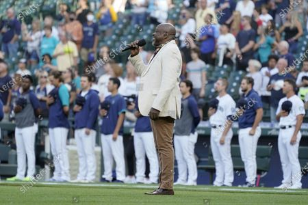 Seattle singer and rapper Wanz, known for his work with Macklemore, sings the national anthem before a baseball game between the Seattle Mariners and the Houston Astros, in Seattle