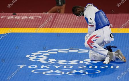Britain's Mahama Cho, bows after being defeated by China's Sun Hongyi during the taekwondo men's 80kg match at the 2020 Summer Olympics, in Tokyo, Japan