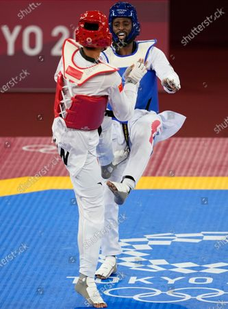 Britain's Mahama Cho, attacks China's Sun Hongyi during the taekwondo men's 80kg match at the 2020 Summer Olympics, in Tokyo, Japan