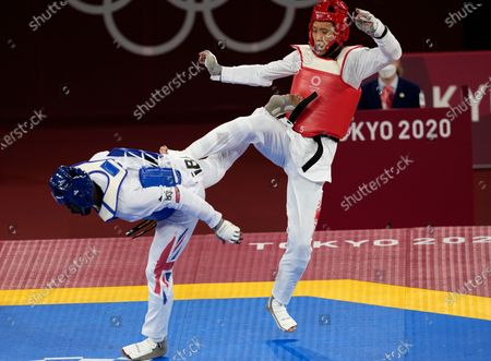 Stock Picture of Britain's Mahama Cho, left, attacks China's Sun Hongyi during the taekwondo men's 80kg match at the 2020 Summer Olympics, in Tokyo, Japan