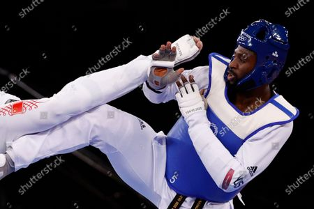Mahama Cho of Great Britain (blue) in action against Hongyi Sun of China during the Taekwondo Men -80kg round of 16 at the Tokyo 2020 Olympic Games at the Makuhari Messe convention centre in Chiba, Japan, 27 July 2021.