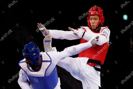 Hongyi Sun of China (red) in action against Mahama Cho of Great Britain during the Taekwondo Men -80kg round of 16 at the Tokyo 2020 Olympic Games at the Makuhari Messe convention centre in Chiba, Japan, 27 July 2021.