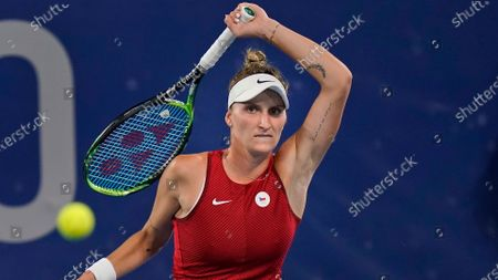 Marketa Vondrousova, of the Czech Republic, plays Naomi Osaka, of Japan, during the third round of the tennis competition at the 2020 Summer Olympics, in Tokyo, Japan