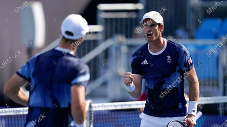 Andy Murray, of Britain, reacts with teammate Joe Salisbury during a men's doubles tennis match against Kevin Krawietz and Tim Puetz, of Germany, at the 2020 Summer Olympics, in Tokyo, Japan