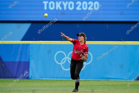 Canada's Jennifer Gilbert throws after fielding a hit by Mexico's Chelsea Gonzales in the fourth inning of a softball game at the 2020 Summer Olympics, in Yokohama, Japan