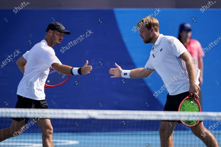 Tim Puetz, left, and Kevin Krawietz of Germany, react during a men's doubles tennis match against Andy Murray and Joe Salisbury, of Britain, at the 2020 Summer Olympics, in Tokyo, Japan