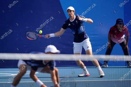 Andy Murray, of Britain, returns to Kevin Krawietz and Tim Puetz, of Germany, during a men's doubles tennis match at the 2020 Summer Olympics, in Tokyo, Japan