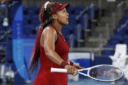 Stock Photo of Naomi Osaka of Japan reacts after losing a point against Marketa Vondrousova of the Czech Republic during the  Women's Singles Third Round Tennis events of the Tokyo 2020 Olympic Games at the Ariake Coliseum in Tokyo, Japan, 27 July 2021.