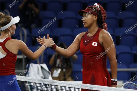 Stock Image of Naomi Osaka of Japan shakes hands with Marketa Vondrousova of the Czech Republic after her upset during the  Women's Singles Third Round Tennis events of the Tokyo 2020 Olympic Games at the Ariake Coliseum in Tokyo, Japan, 27 July 2021.