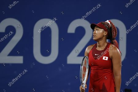 Stock Picture of Naomi Osaka of Japan reacts after losing a point against Marketa Vondrousova of the Czech Republic during the  Women's Singles Third Round Tennis events of the Tokyo 2020 Olympic Games at the Ariake Coliseum in Tokyo, Japan, 27 July 2021.
