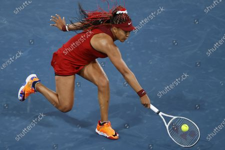 Naomi Osaka of Japan in action against Marketa Vondrousova of the Czech Republic during the Women's Singles Third Round Tennis events of the Tokyo 2020 Olympic Games at the Ariake Coliseum in Tokyo, Japan, 27 July 2021.
