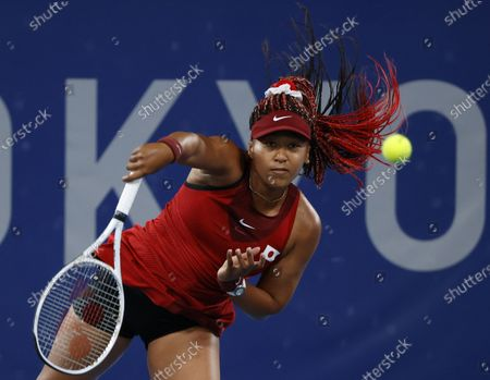 Naomi Osaka of Japan serves against Marketa Vondrousova of the Czech Republic during the Women's Singles Third Round Tennis events of the Tokyo 2020 Olympic Games at the Ariake Coliseum in Tokyo, Japan, 27 July 2021.