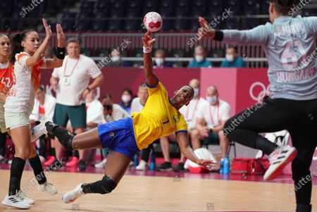 Ramires de Araujo of Brazil in action against  goalie Kings Janurik of Hungary during the Women's Handball preliminary round group B match of Tokyo 2020 Olympic Games at Yoyogi National Stadium in Tokyo, Japan, 27 July 2021.