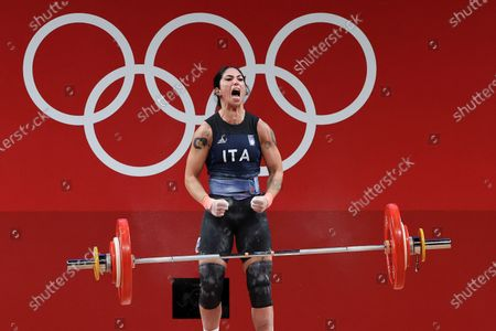 Stock Picture of Maria Grazia Alemanno of Italy celebrates after an attempt in the Women's 59kg Group B during the Weightlifting events of the Tokyo 2020 Olympic Games at the Tokyo International Forum in Tokyo, Japan, 27 July 2021.