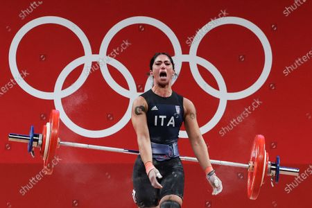 Stock Image of Maria Grazia Alemanno of Italy celebrates after an attempt in the Women's 59kg Group B during the Weightlifting events of the Tokyo 2020 Olympic Games at the Tokyo International Forum in Tokyo, Japan, 27 July 2021.