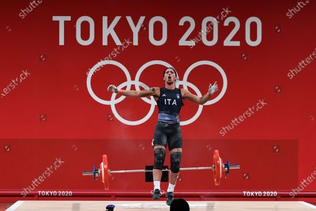 Stock Photo of Maria Grazia Alemanno of Italy reacts after an attempt in the Women's 59kg Group B during the Weightlifting events of the Tokyo 2020 Olympic Games at the Tokyo International Forum in Tokyo, Japan, 27 July 2021.
