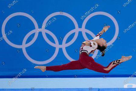 Stock Image of Pauline Schaefer-Betz, of Germany, performs her floor exercise routine during the women's artistic gymnastic qualifications at the 2020 Summer Olympics, in Tokyo. The German gymnastics team wore full-legged unitards that went down to their ankles, eschewing the traditional bikini cut that ends high on the hip. The athletes said they were trying to combat the sexualization of young women and girls in their sport, which is trying to recover from a decades-long sexual abuse scandal