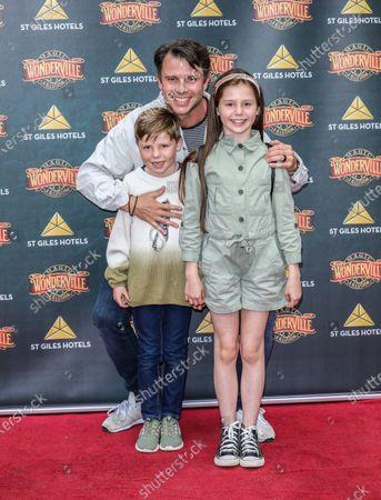 Stock Photo of Neil McDermott and children
