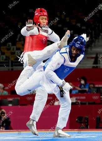 Stock Image of (210727) - TOKYO, July 27, 2021 (Xinhua) - Sun Hongyi of China (L) skills against Mahama Cho of Britain during the men's 80kg+ taekwondo round of 16 match at the Tokyo 2020 Olympic Games in Tokyo, Japan, July 27, 2021.
